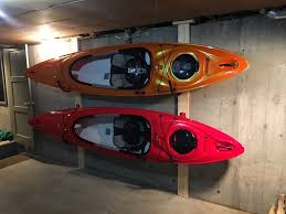 Best Kayak Ceiling Hoist by Clean Up Your Garage By Storing Your Kayaks In A Wall Rack