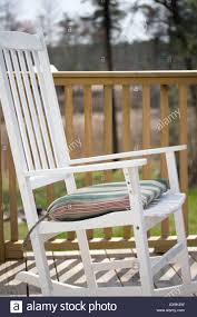 White Rocking Chair On Wooden Deck Or Porch Stock Photo ... Front Porch Of House With White Rocking Chairs On Wooden Two Wood Rocking Chair Isolate Is On White Background With Indoor Chairs Grey Wooden Northbeam Acacia Outdoor Stock Image Yellow Fniture Club By Trex In Photo Free Trial Bigstock Small Old Toy Edit Now Karlory Porch Rocker 100 Pure Natural Solid Deck Patio Backyard Living Room Black Isolated