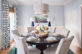 Modern Dining Room With Dark Blue Accents Geometric Curtains