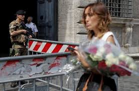 A Woman Holds Flowers To Pay Tribute The Victims Of Bastille Day Truck Attack