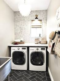 small space for laundry room with black slate floor by greige