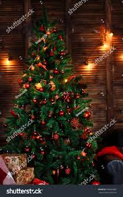 Green Christmas Tree Decorated With Red Toys Ornaments Pine Cones