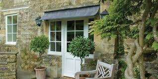 patio door awnings uk door shelters uk our range of door and window canopies is the