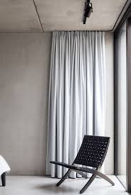 how to hang curtains over vertical blinds without drilling easy