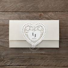 Envelope Fold Invite With A Lovely Embossed Heart Shaped Center Highlighting The CoupleaEURTMs
