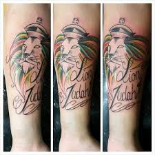 Simple Lion Tattoo Of Judah With Mane From Red Green And Yellow Colours Crown