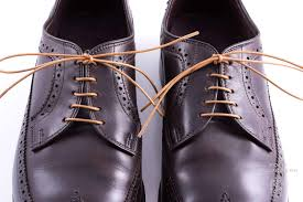 Light Brown Cotton Shoelaces On Dark Derby Shoes With Bar Lacing