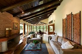 Classic Rustic Living Room With Brown Beams And Tan Couch