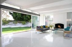 Open To Back Yard And View White Terrazzo Floors