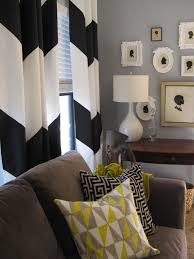 silhouettes and chevron curtain living room vignette eclectic