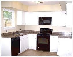 White Kitchen Black Appliances Cabinets Home Design Ideas With