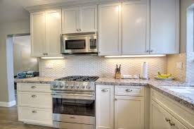 cottage kitchen with tile by classic home improvements
