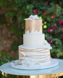 Close up of the gorgeous white and gold wedding cake by sljbakery