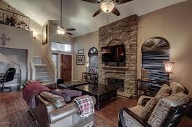 Rustic Living Room With Stone Fireplace Loft Ceiling Fan High Arched