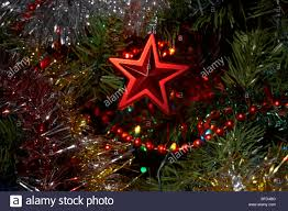 Red Star Decoration Hanging On An Artificial Christmas Tree
