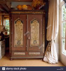 Painted Antique Armoire Beside Window With Heavy Cream Curtain In ... 72 Best Antique Armoire Images On Pinterest Armoire 33 Bureau And Cupboards Painted Antique Beside Window With Heavy Cream Curtain In Closet French Wardrobe Storage Fniture Abolishrmcom Vintage Fniture With Mirror Lawrahetcom An Overview Of Elites Home Decor Hutch Ladybirds Mandeville La At Geebo Wardrobe Closet Massachusetts Ideas All Home
