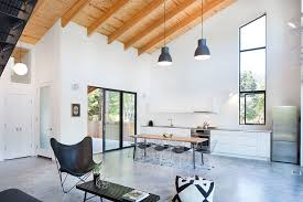 Interior In Neutral Hues With A Tilted Wooden Ceiling And Stylish Windows
