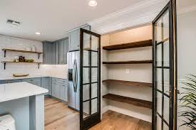 Kitchen Pantry With Stacked Reclaimed Wood Shelves