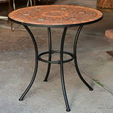 outdoor patio bistro table with terracotta mosaic tiles and