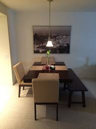 Dining room table and chairs inside of my apartment The bench