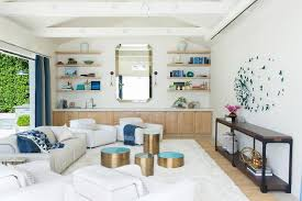 white and blue living room with mirror wall of low light oak