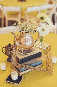 Vintage Wedding Centerpieces Of Frames Tea Pots And Old Books