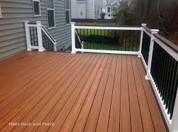 trexcompany composite deck using tiki torch flooring and spiced