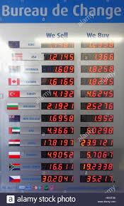 bureau de change en bureau de change display board showing rates of exchange stock photo