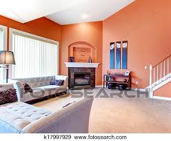 orange gemuetlicher wohnzimmer mit teppich boden weiß