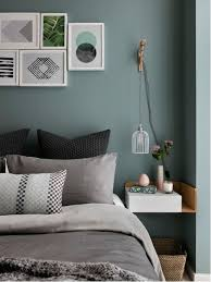 Example Of A Danish Carpeted Bedroom Design In London With Blue Walls