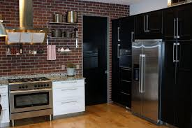 Awesome Brick Wall Kitchen Design Using Black Cabinet And Mount Range Hood Plus White Marble Counertop