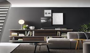 Lovely Use Of Grey In The Living Room To Complement Trendy Wall Unit And Decorations According Modern Standards
