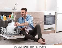 Man Unloading Dishwasher Happy Handsome