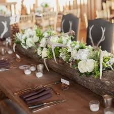 Hollowed Log Centerpiece With Deer Antlers Love This For A Rustic Reception