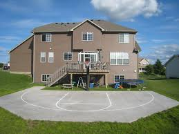 A Great Look At A Backyard Court Making Efficient Use Of Concrete ... Outdoor Courts For Sport Backyard Basketball Court Gym Floors 6 Reasons To Install A Synlawn Design Enchanting Flooring Backyards Winsome Surfaces And Paint 50 Quecasita Download Cost Garden Splendid A 123 Installation Large Patio Turned System Photo Album Fascating Paver Yard Decor Ideas Building The At The American Center Youtube With Images On And Commercial Facilities
