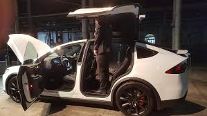 Tesla Model X SUV falcon wing doors cause safety fears