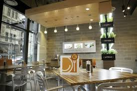 The Bright Airy Decor At Lyfe Kitchen Incorporates Fresh Elements Like A Living Herb Wall