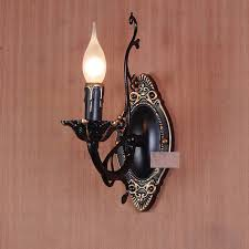 black candle wall sconces with golden carving patterns