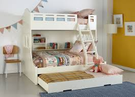 Kids White Snow Bunk Bed With Trundle And Built In Shelving Pastel Coloured Patterned Linen