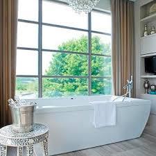 Modern Chandelier Over Bathtub by Bathtub In Front Of Window Contemporary Bathroom Kimberley
