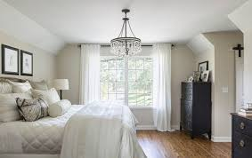 Mid Sized Elegant Master Medium Tone Wood Floor Bedroom Photo In Minneapolis With Beige Walls