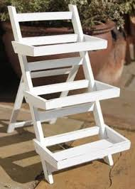 Patio Plant Stands Wheels cottage style 3 tier garden planter on wheels plant rack flower