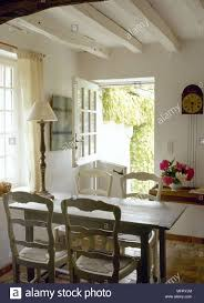 French Country Dining Room Beamed Ceiling Stable Door Table ... 100 French Country Ding Room Fniture Old Amazoncom Baxton Studio Laurence Cottage 5 Country Ding Room Beamed Ceiling Stable Door Table In Layjao Pair Ethan Allen Ladder Back Arm Charming Decor Ideas For Your Home Chairs White Set Wwwxandfiddlecaliforniacom Vase Of White Roses On Set Lunch With Plates 19 Examples Dcor Fniture Decoration Designs Guide Style Tables Sydney Parquetry Elm Timber
