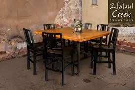 Walnut Creek Furniture industrial table with six wooden chairs