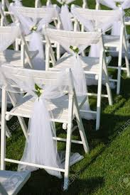 White Decorated Chairs On A Green Lawn. Chairs Set In Rows For.. 16 Easy Wedding Chair Decoration Ideas Twis Weddings Beautiful Place For Outside Wedding Ceremony In City Park Many White Chairs Decorated With Fresh Flowers On A Green Can Plastic Folding Chairs Look Elegant For My Event Ctc Ivory Us 911 18 Offburlap Sashes Cover Jute Tie Bow Burlap Table Runner Burlap Lace Tableware Pouch Banquet Home Rustic Decorationin Spandex Party Decorations Pink Buy Folding Event And Get Free Shipping Aliexpresscom Linens Inc Lifetime Stretch Fitted Covers Back Do It Yourself Cheap Arch