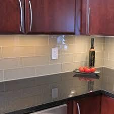 milk and honey home kitchens white glass tile white glass