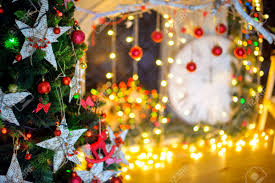 Christmas Decoration On Abstract Background The Decorated Tree Bright Garlands And Jewelry