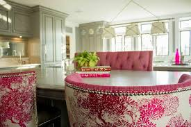 Gray KItchen Island With Pink Tufted Bench And PinkBbarrel Back Counter Stools