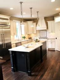 Dark Wood Floors With Cream Cabinets And Island