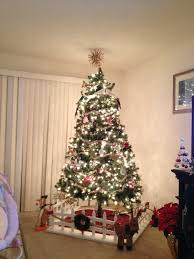 Upright Christmas Tree Storage Bag Uk by A Small Decorative Picket Fence Around The Christmas Tree Helps